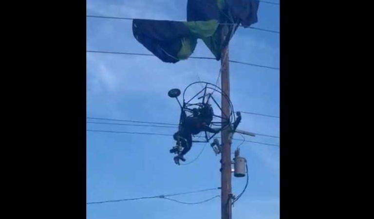 Queda colgando paracaidista sobre cables de luz   VIDEO